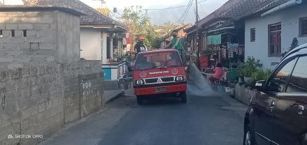 Penyemprotan disinfektan di seluruh wilayah Desa Sangsit